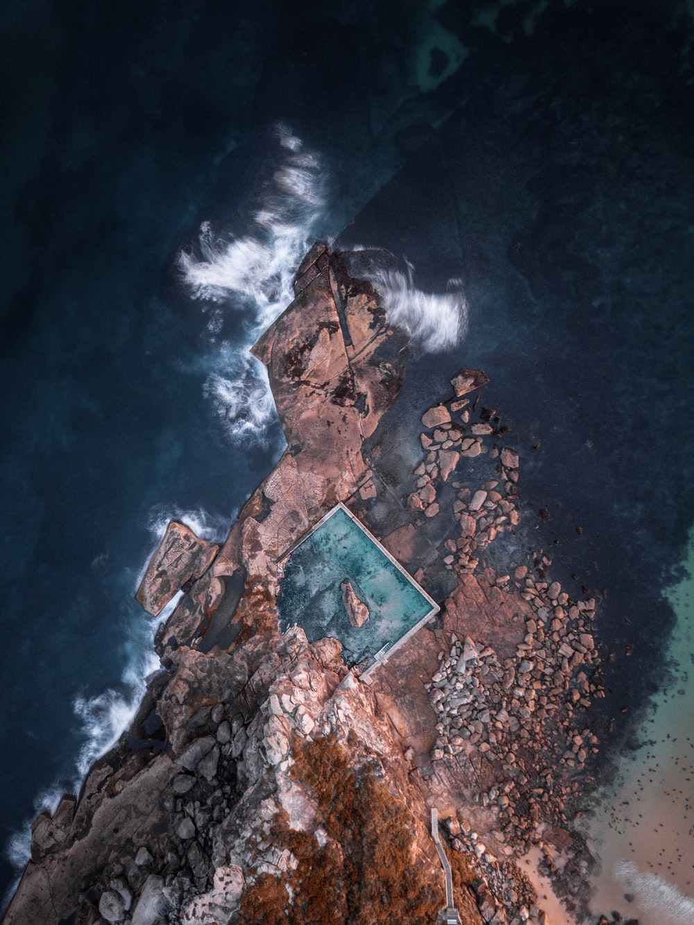 mountain and ocean waves aerial scenery