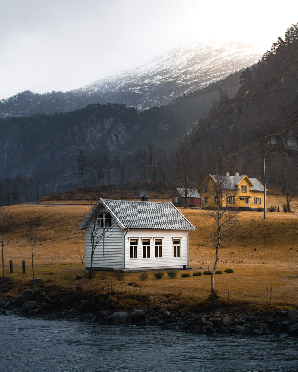 white and gray house with a view of white mountain