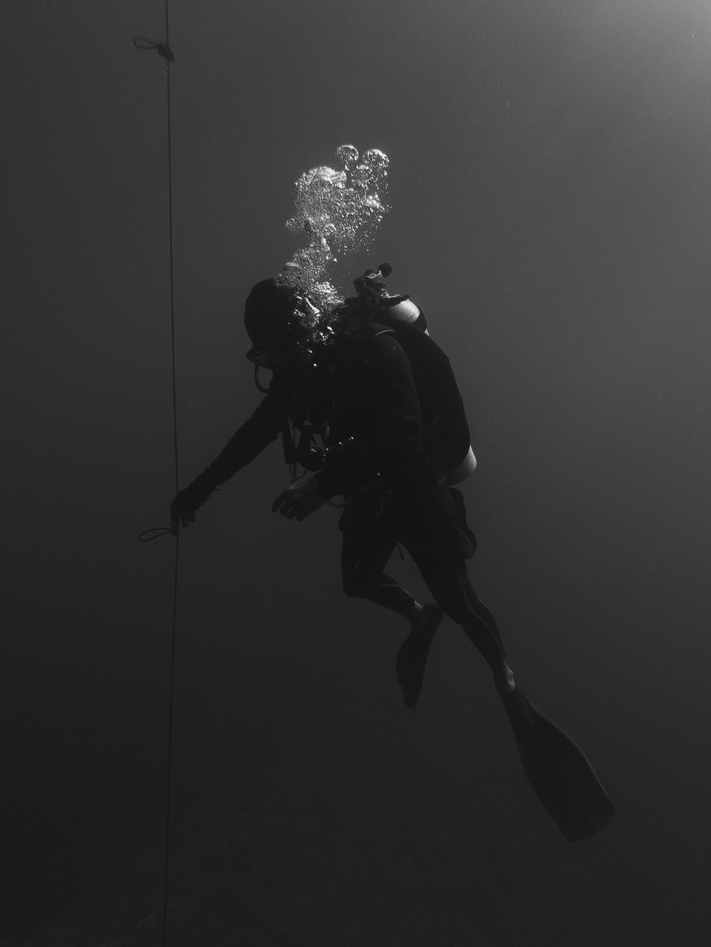 person under water with snorkling equipment