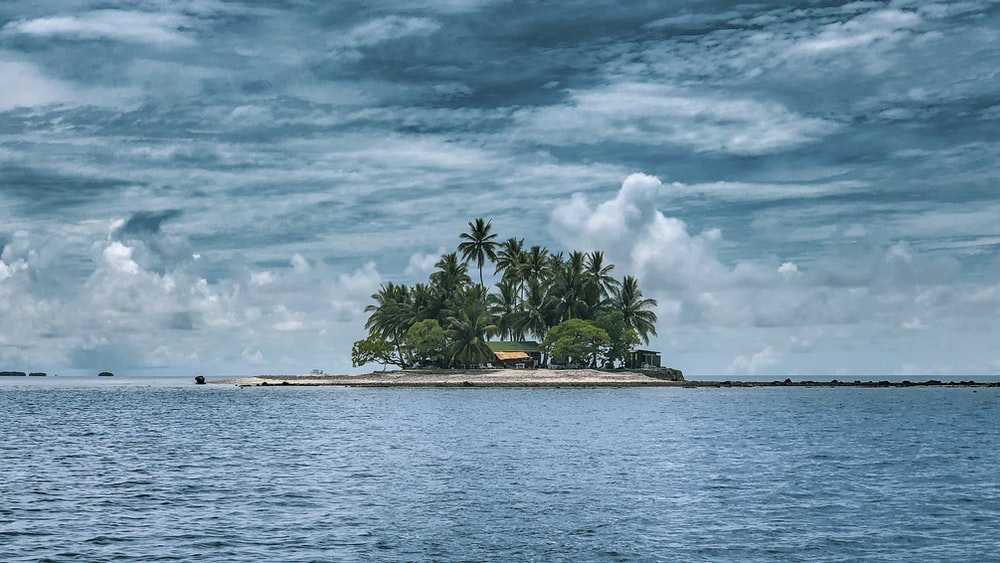 photography of island against sky