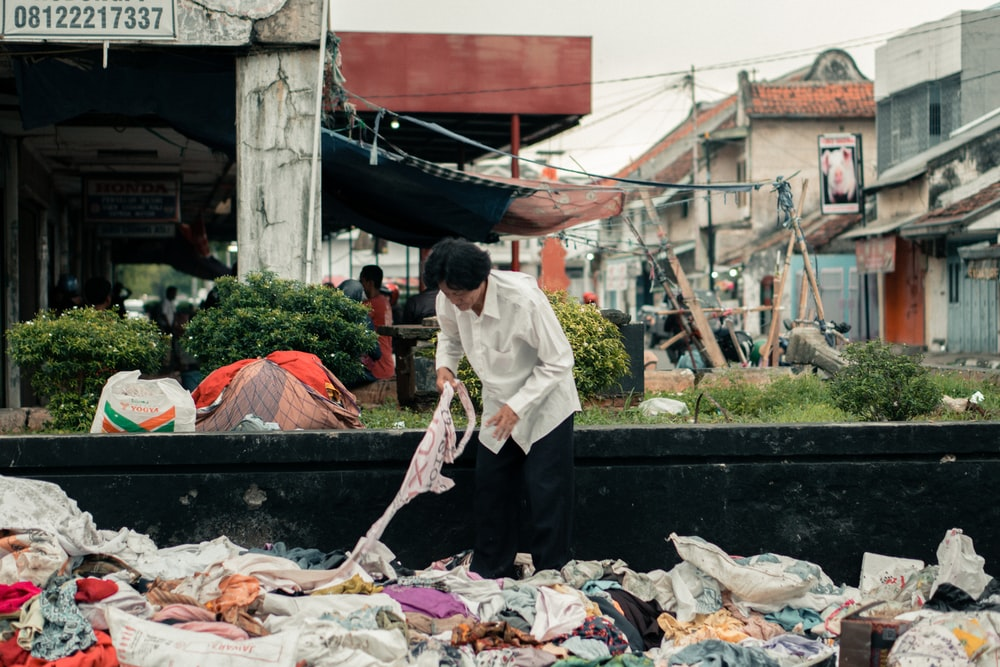 woman picking textile outdoors