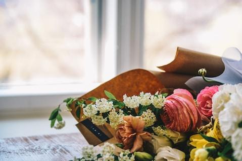 Wreath of flowers beside window