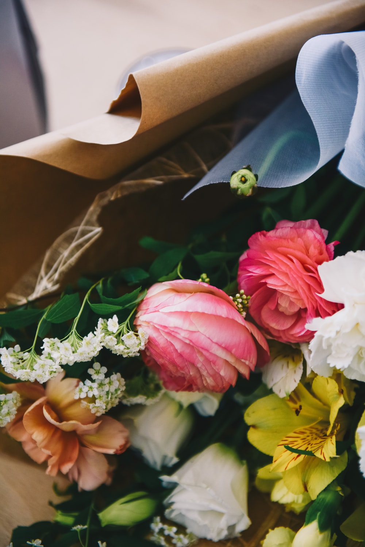 flower bouquet inside paper bag