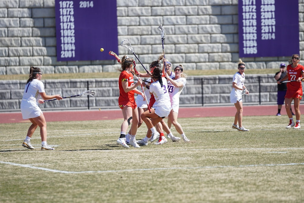 group of women playing lacrosse