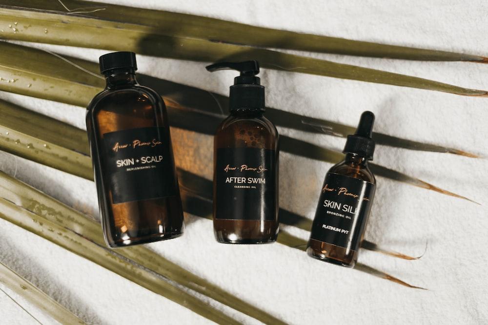 three Skin Scalp labeled bottles