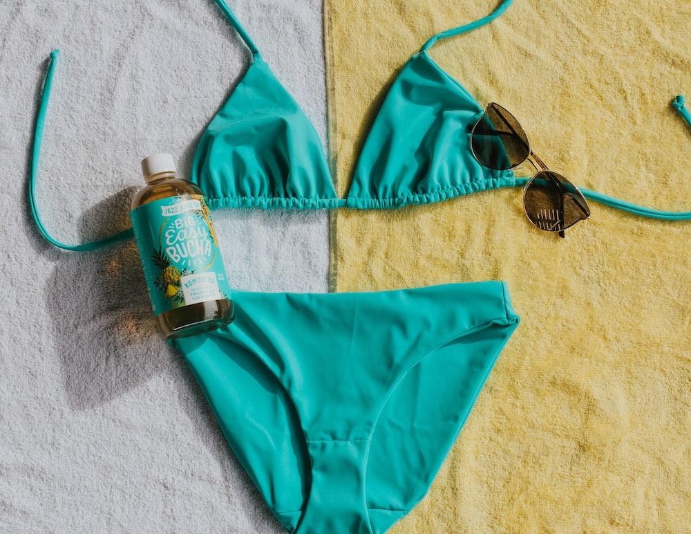 teal bikini on brown surface