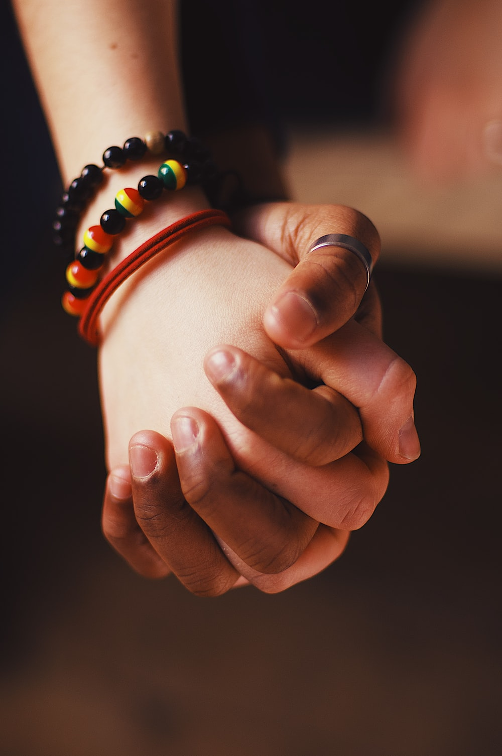 couple holding hands while wearing ring and bangle