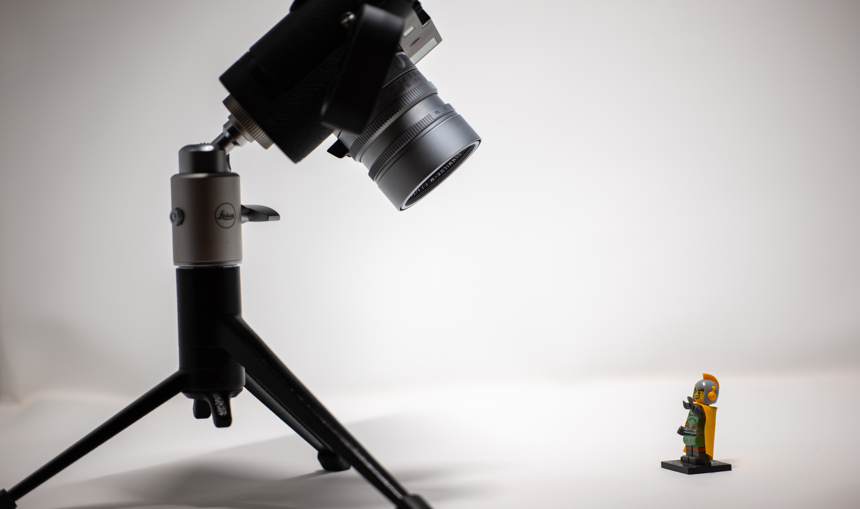 black camera with tripod stand