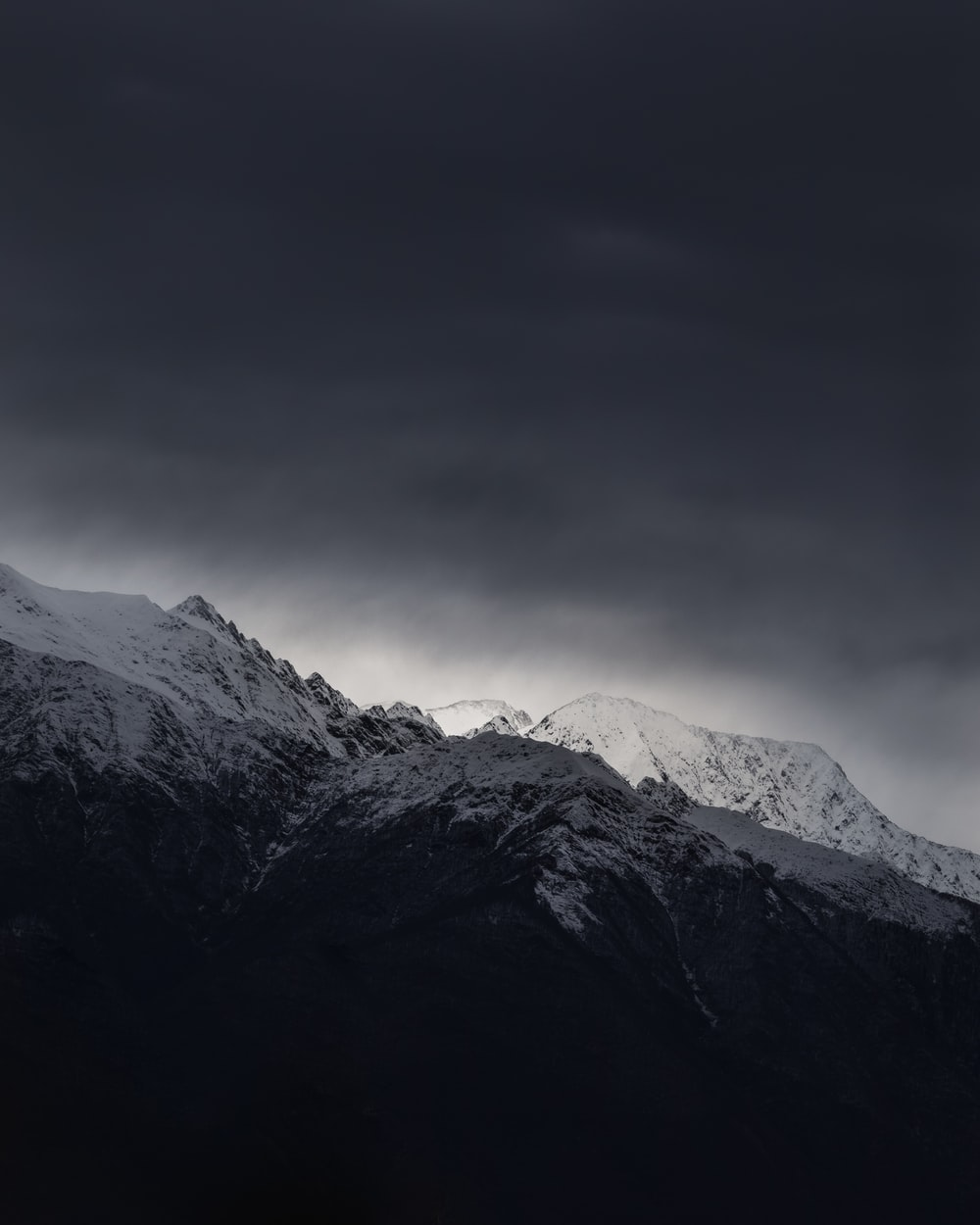 snow capped mountain under cloudy sky during daytime