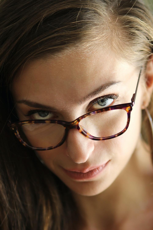 woman wearing brown-framed eyeglasses