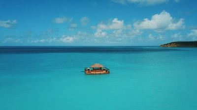 floating house in the middle of sea at daytime antigua and barbuda zoom background