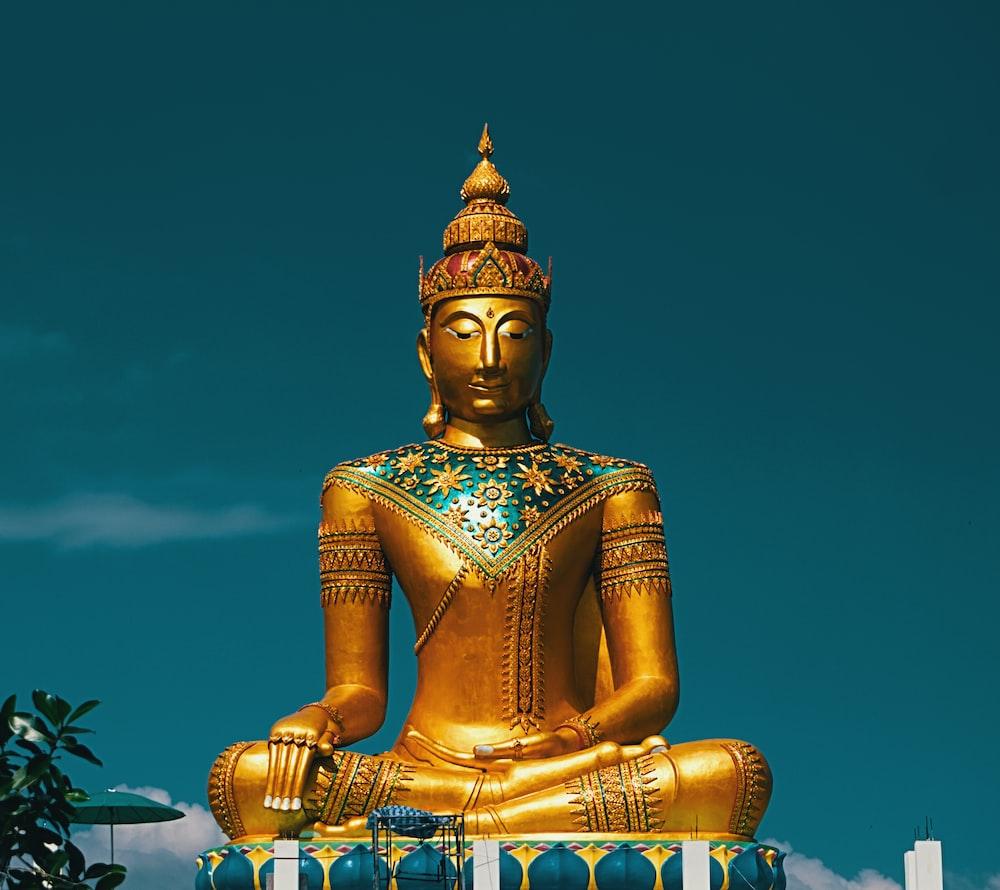 gold-colored Buddha statue