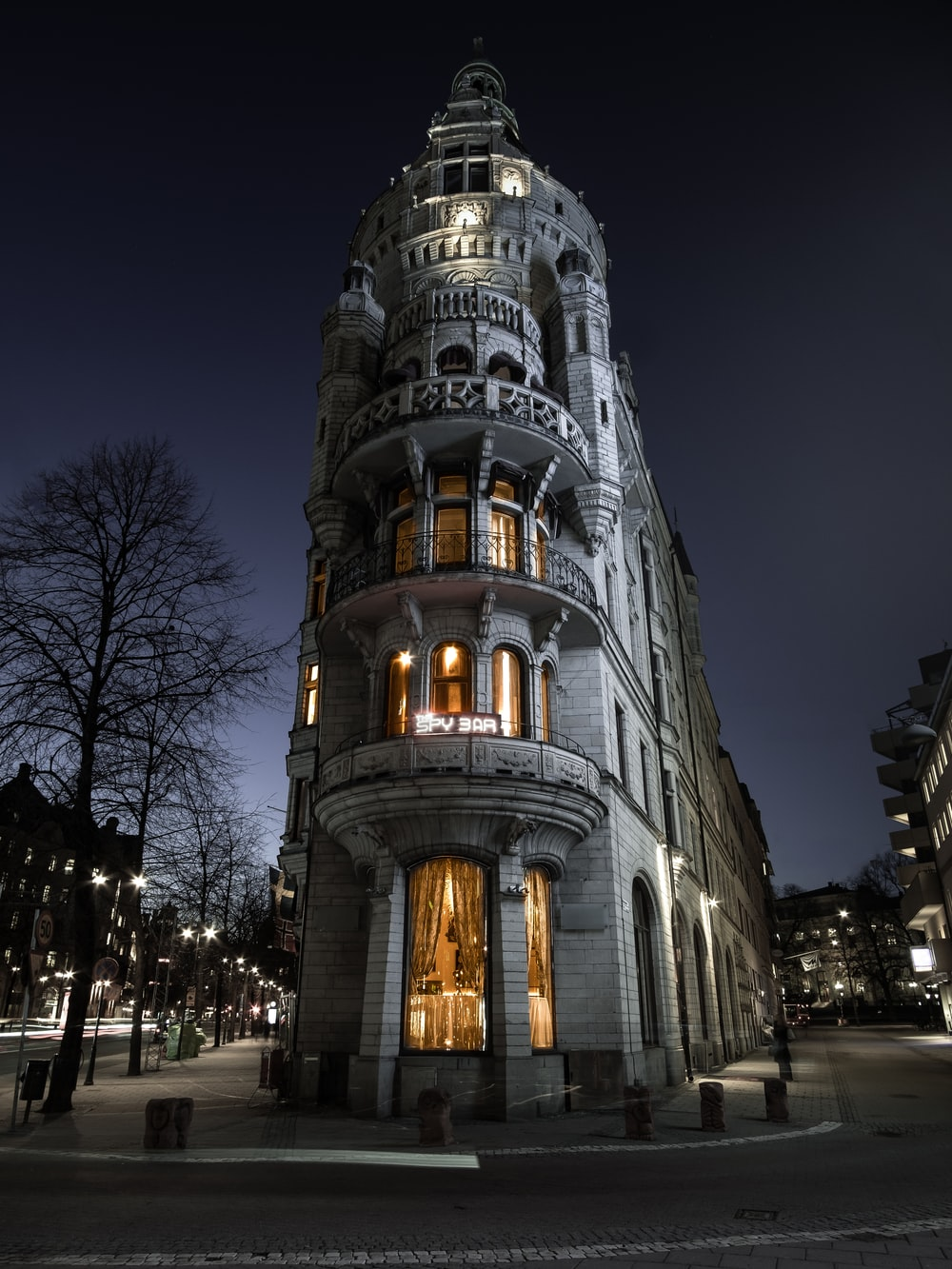 selective color photography of well lighted building at night