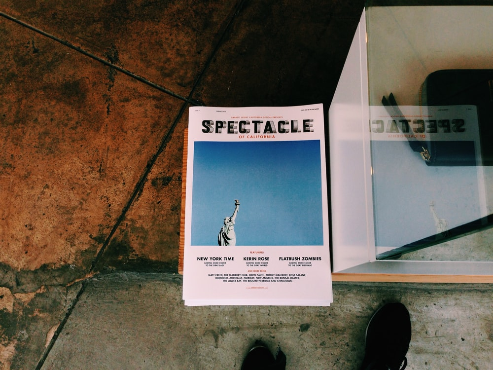 Spectacle book on brown surface