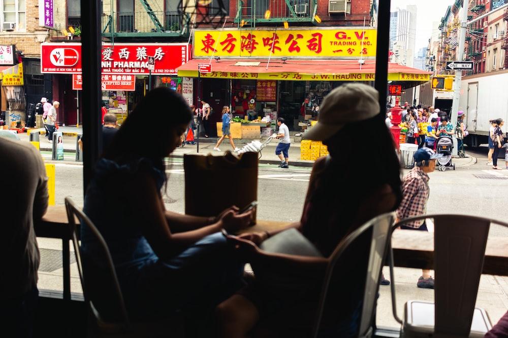 woman sitting beside woman