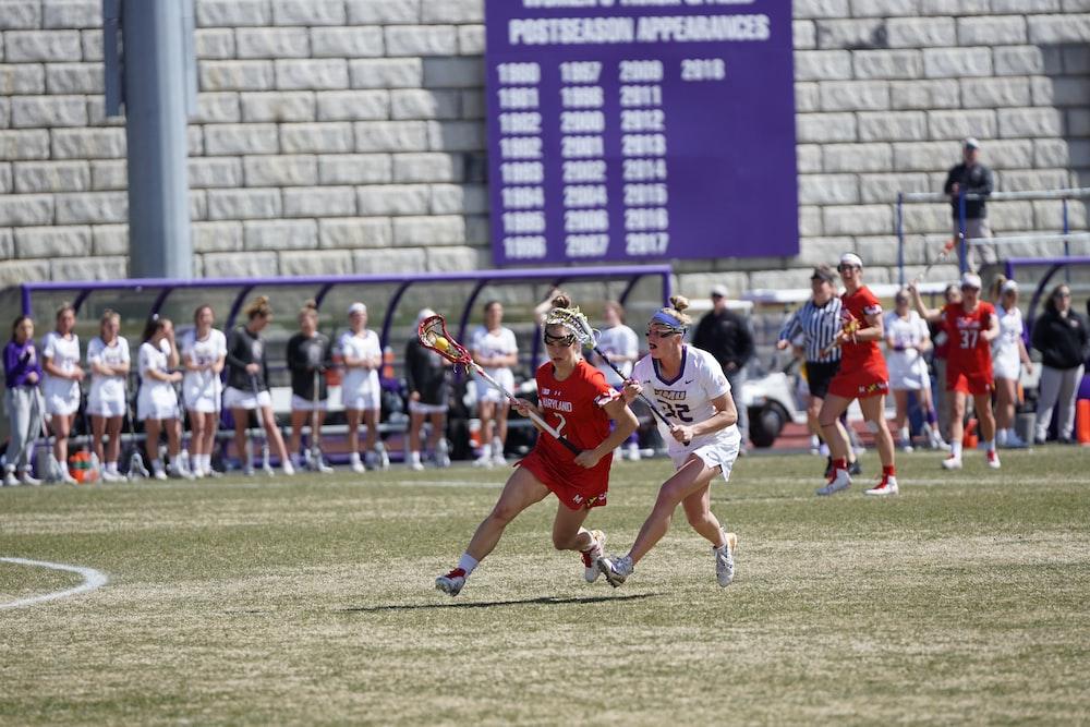 women playing lacrosse during daytime