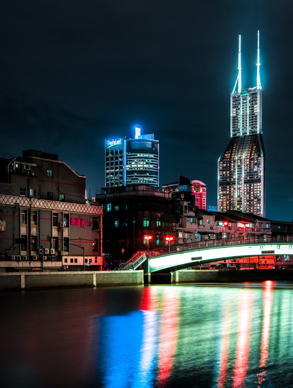 high-rise lighted buildings near body of water