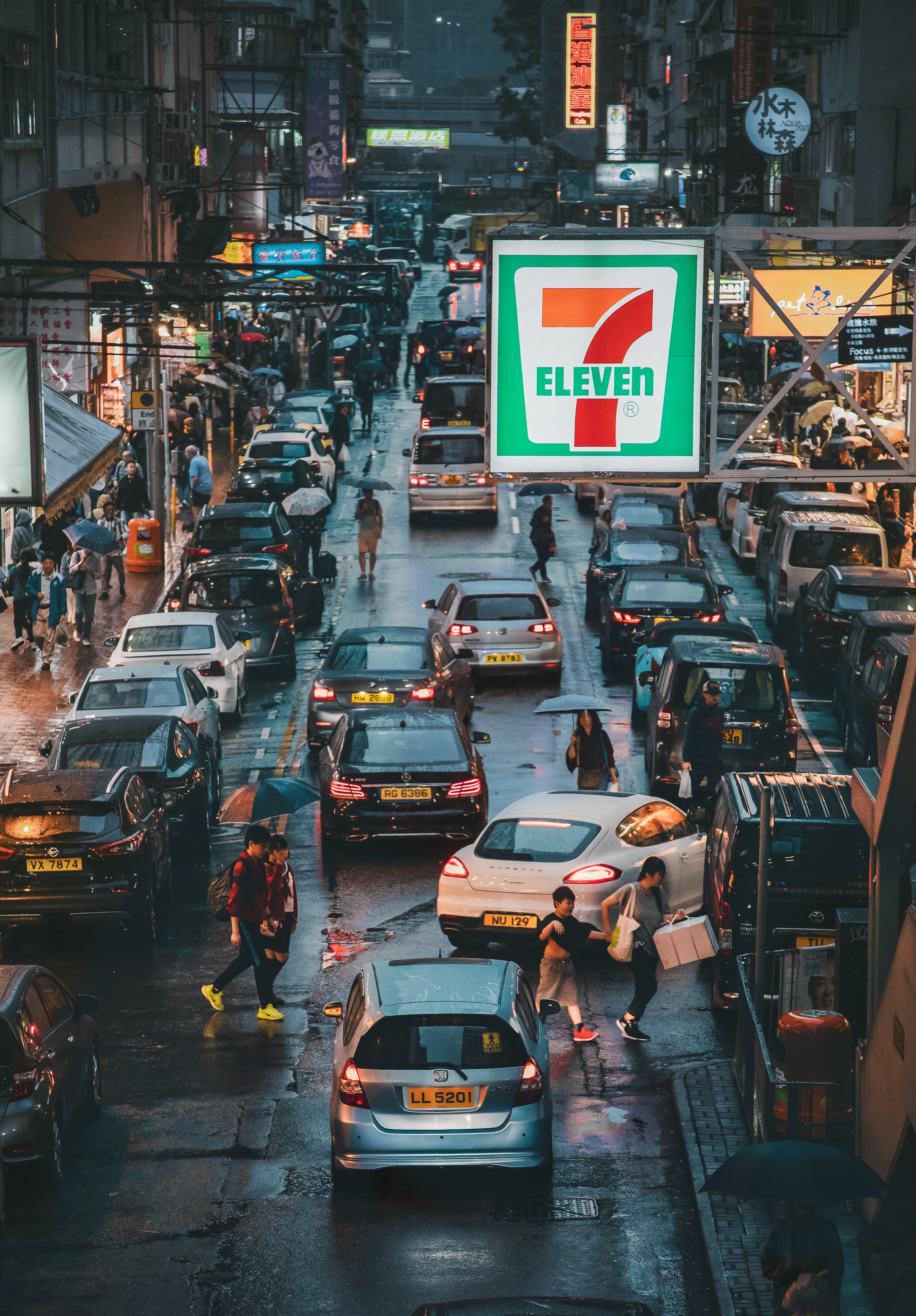 vehicles on road near 7Eleven sign