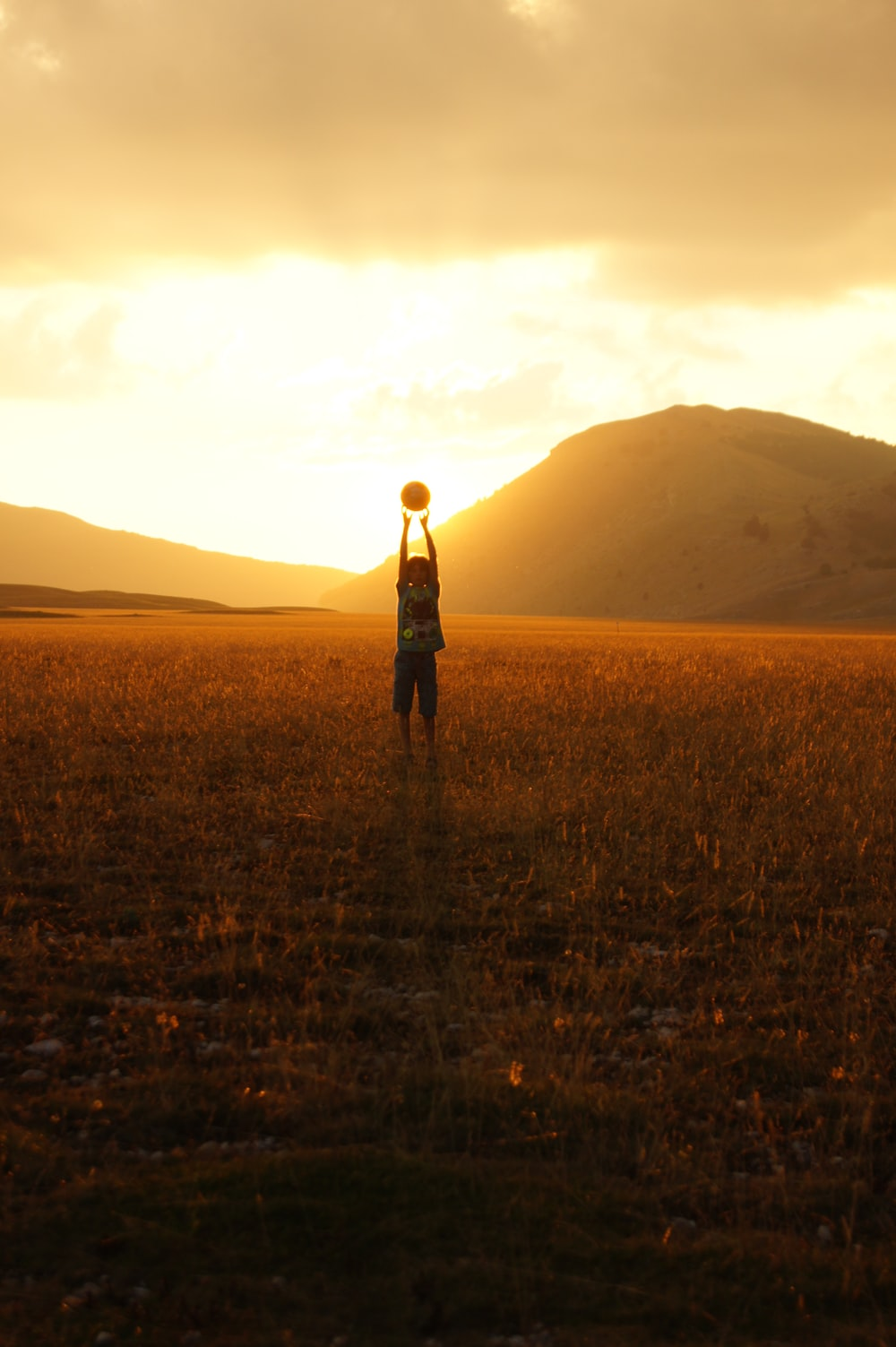 silhouette photography of person standing on field