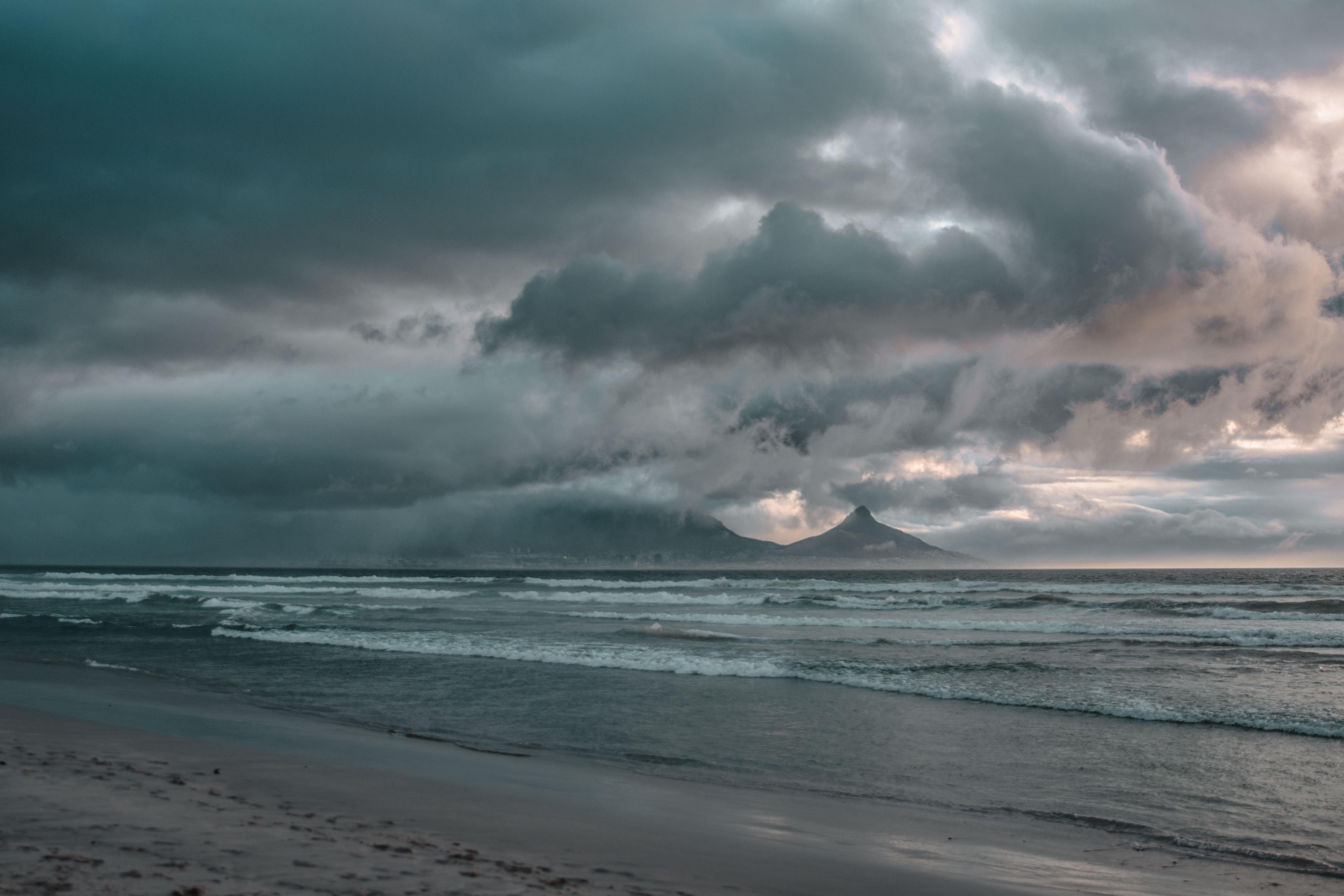 seashore across dark clouds