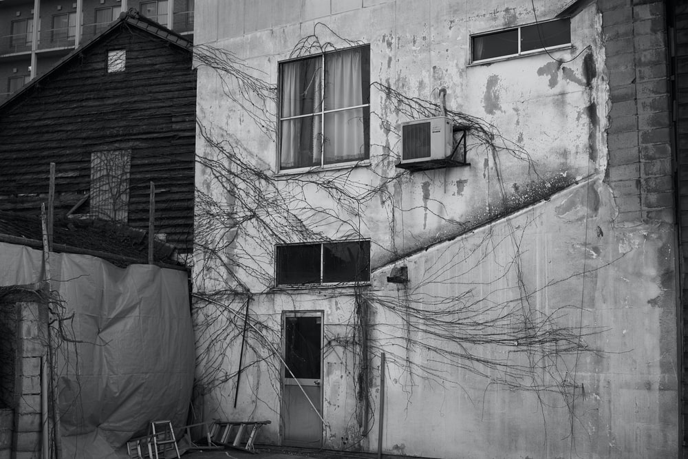 greyscale photography of concrete building
