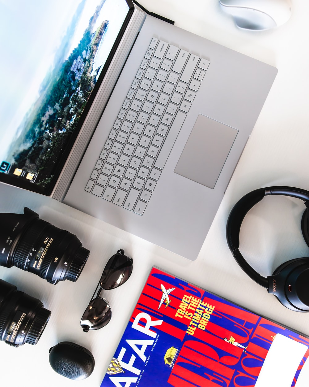 flat lay photography of gray laptop computer and headphones