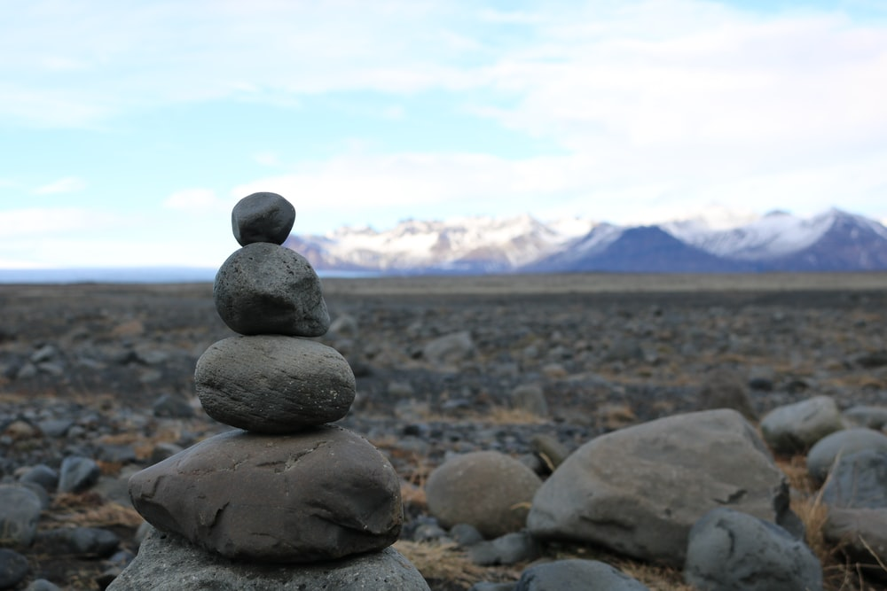 close-up of gray stone balance near mountain