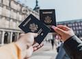 person holding passports