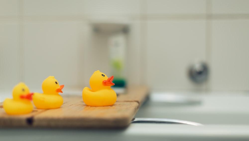 three yellow rubber duckies