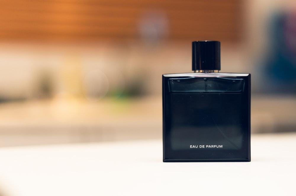 selective focus photography of eau de parfum bottle
