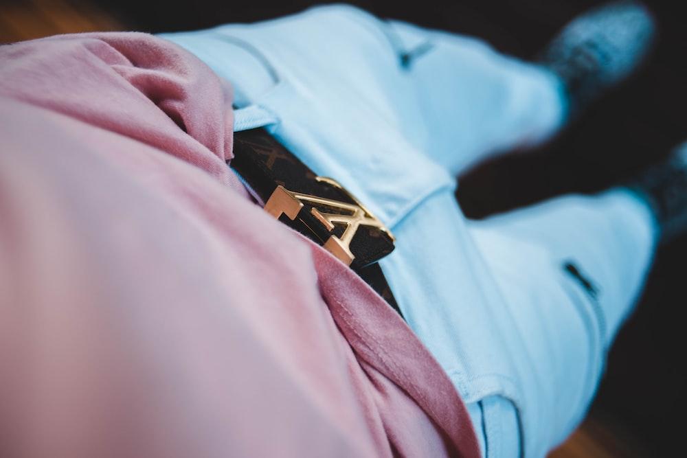 focus photography of black Louis Vuitton belt
