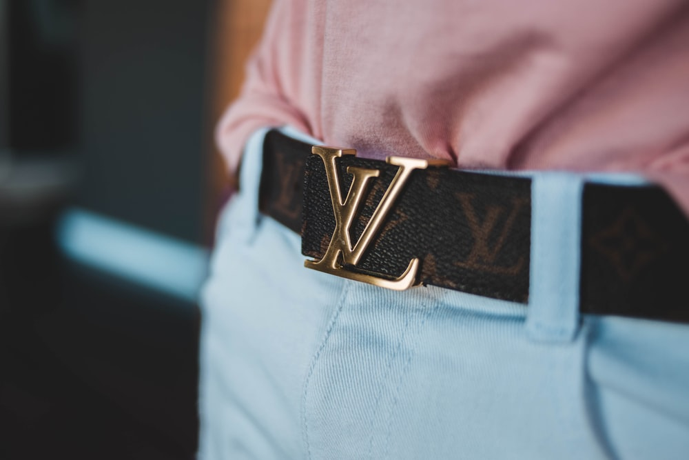 person wearing Louis Vuitton leather belt