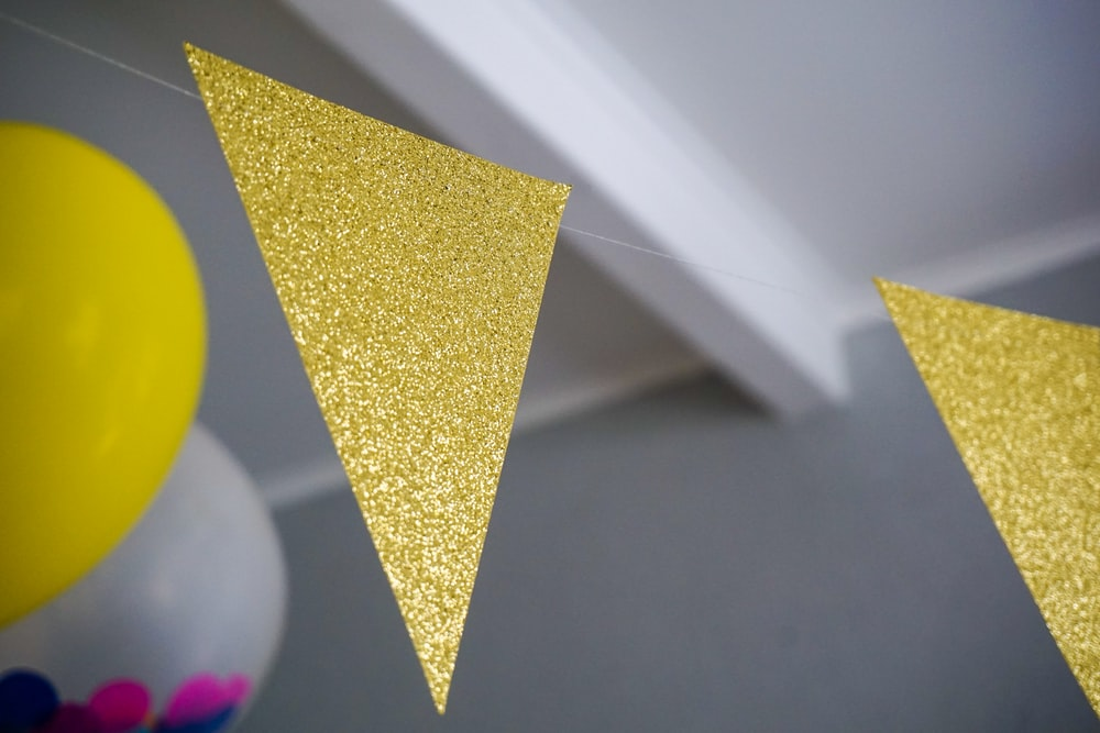 yellow glitter buntings hanging inside room