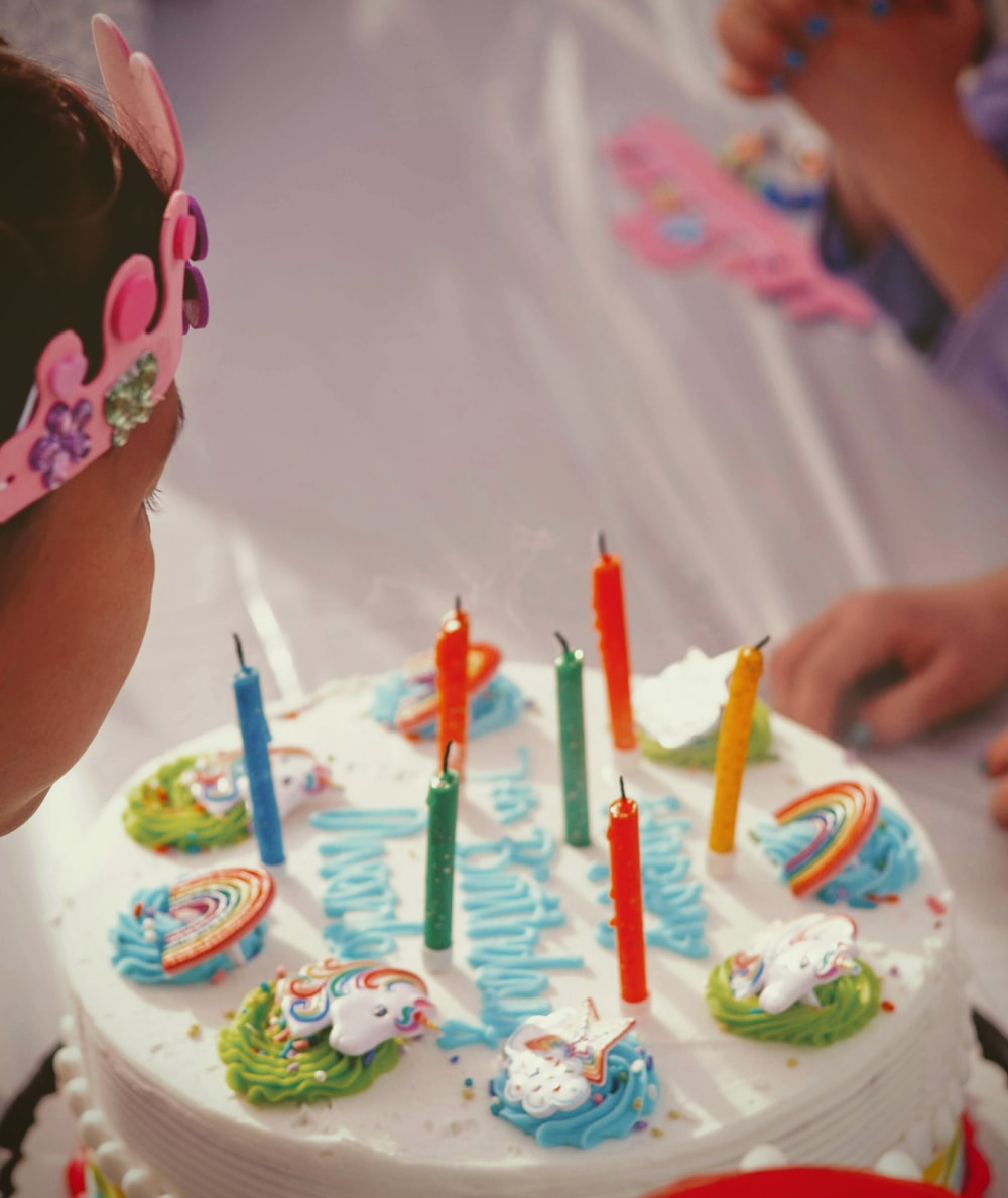 unlighted candles on cake