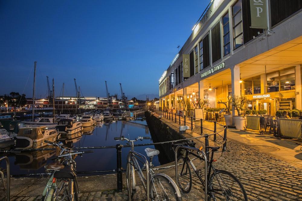 three commuter bikes parked beside harbor