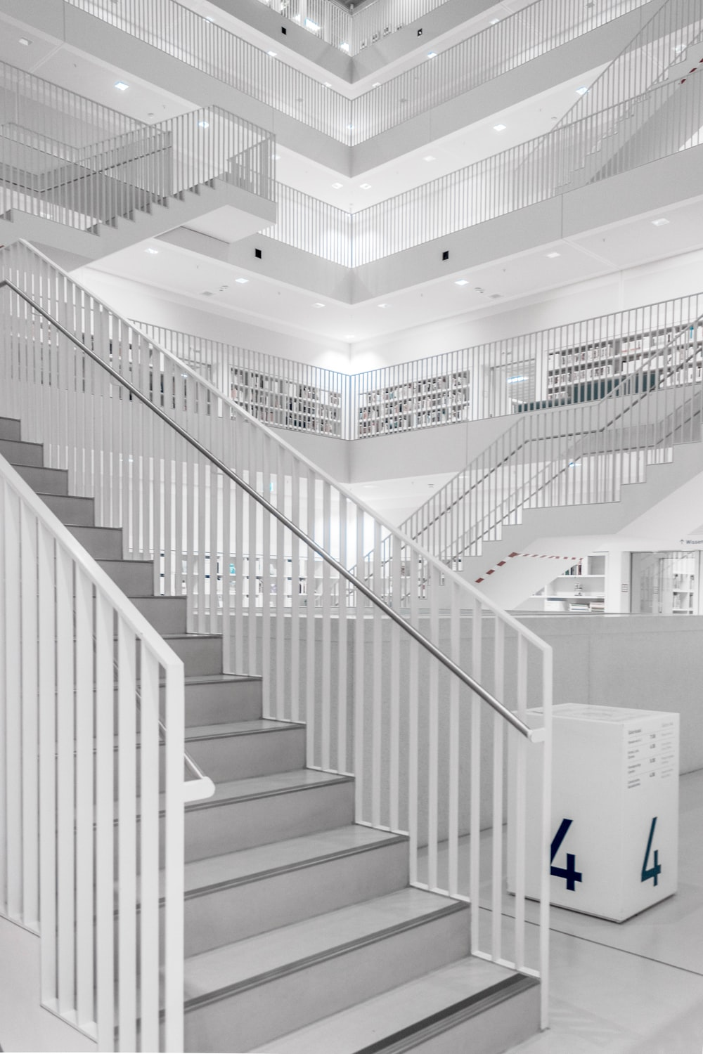 white and grey building staircase