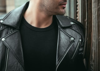 man wearing black leather biker jacket