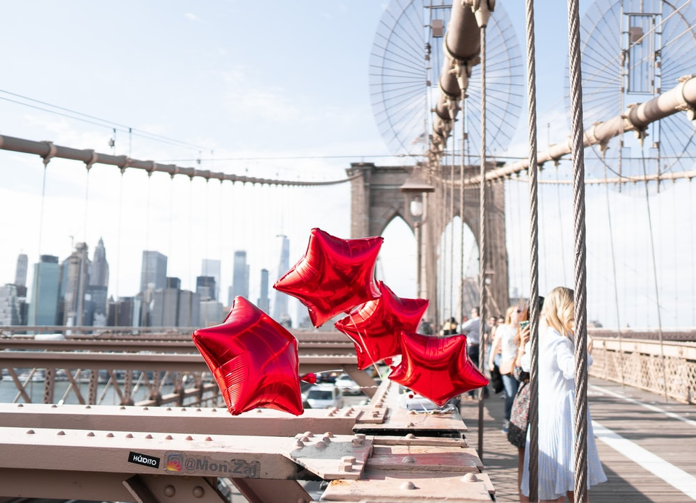 four red star balloons