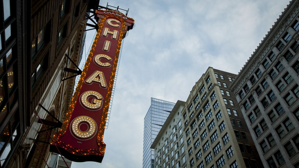 red and white Chicago signage during daytime