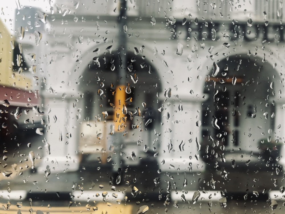 selective focus photography of water drops in window