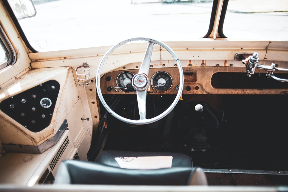brown classic truck dashboard with white steering wheel