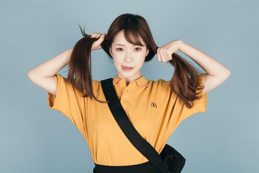 woman wearing yellow polo shirt