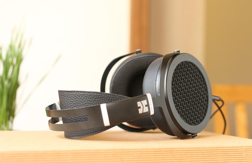 black headset on beige surface
