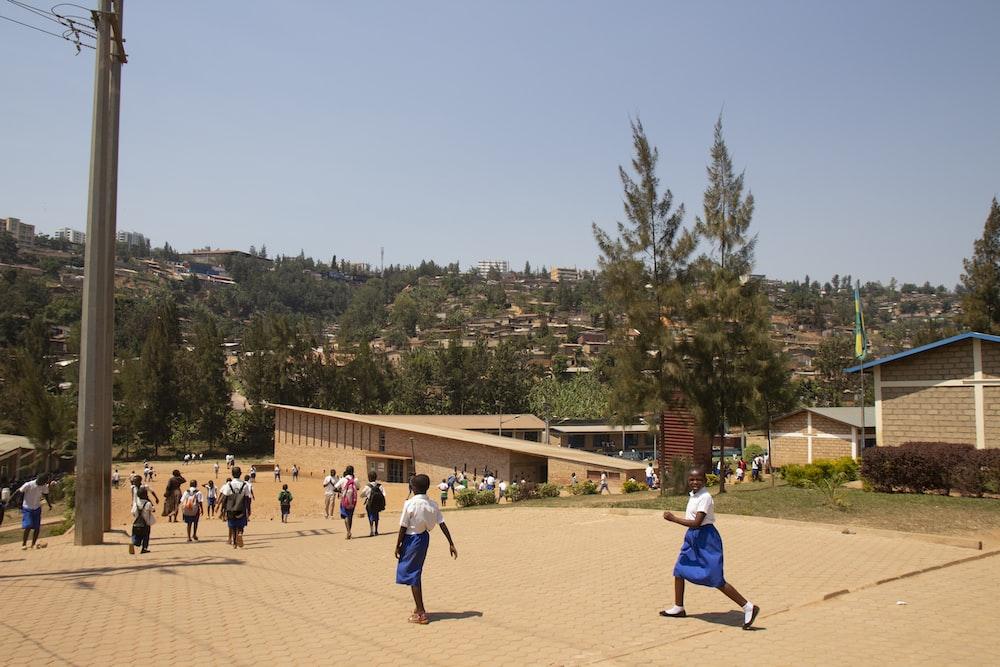 children running near building during daytime