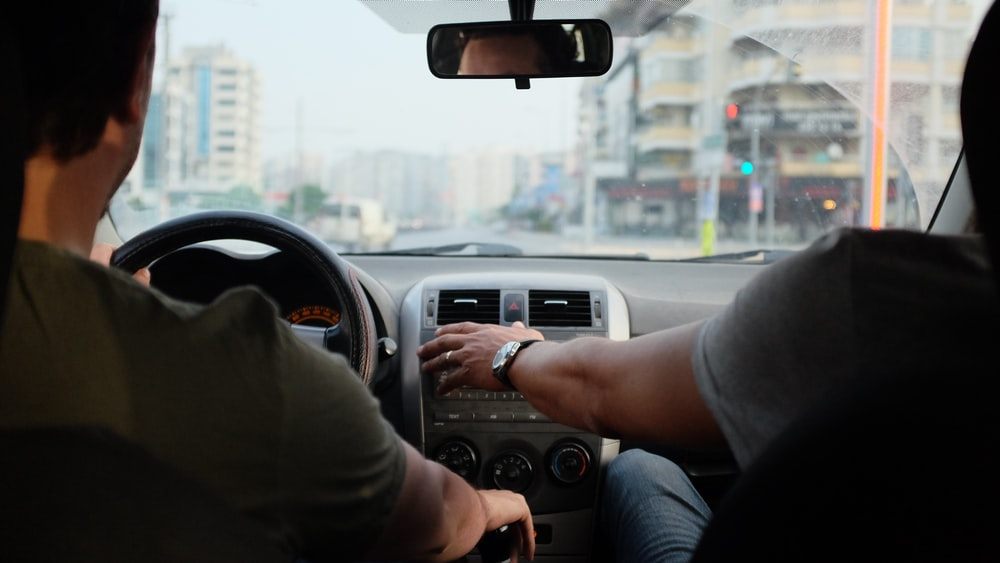 two person riding vehicle during daytime