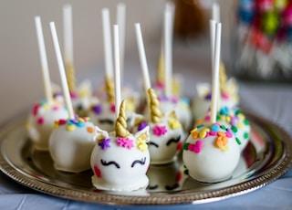 shallow focus photo of unicorn lollipops