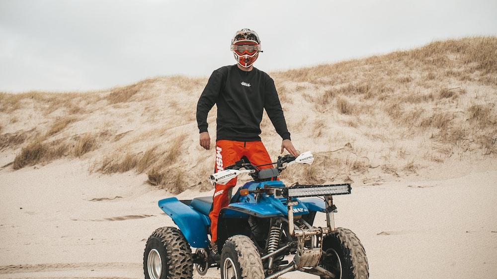 man riding blue ATV during daytim