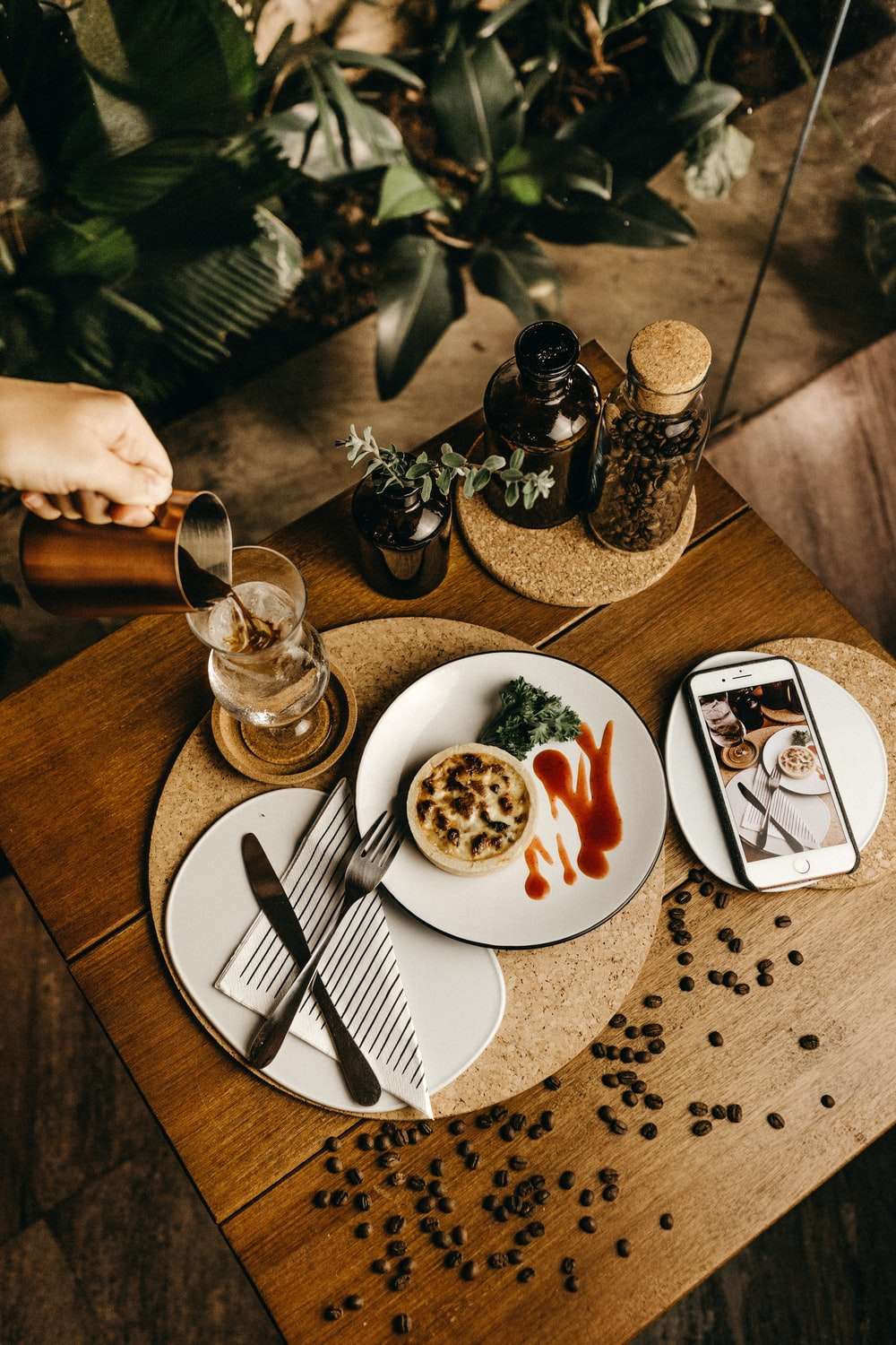 food photography of baked pastry beside stainless steel fork and dinner knife