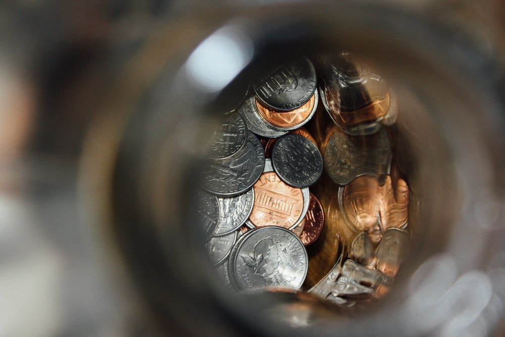 shallow focus photography of coin collection