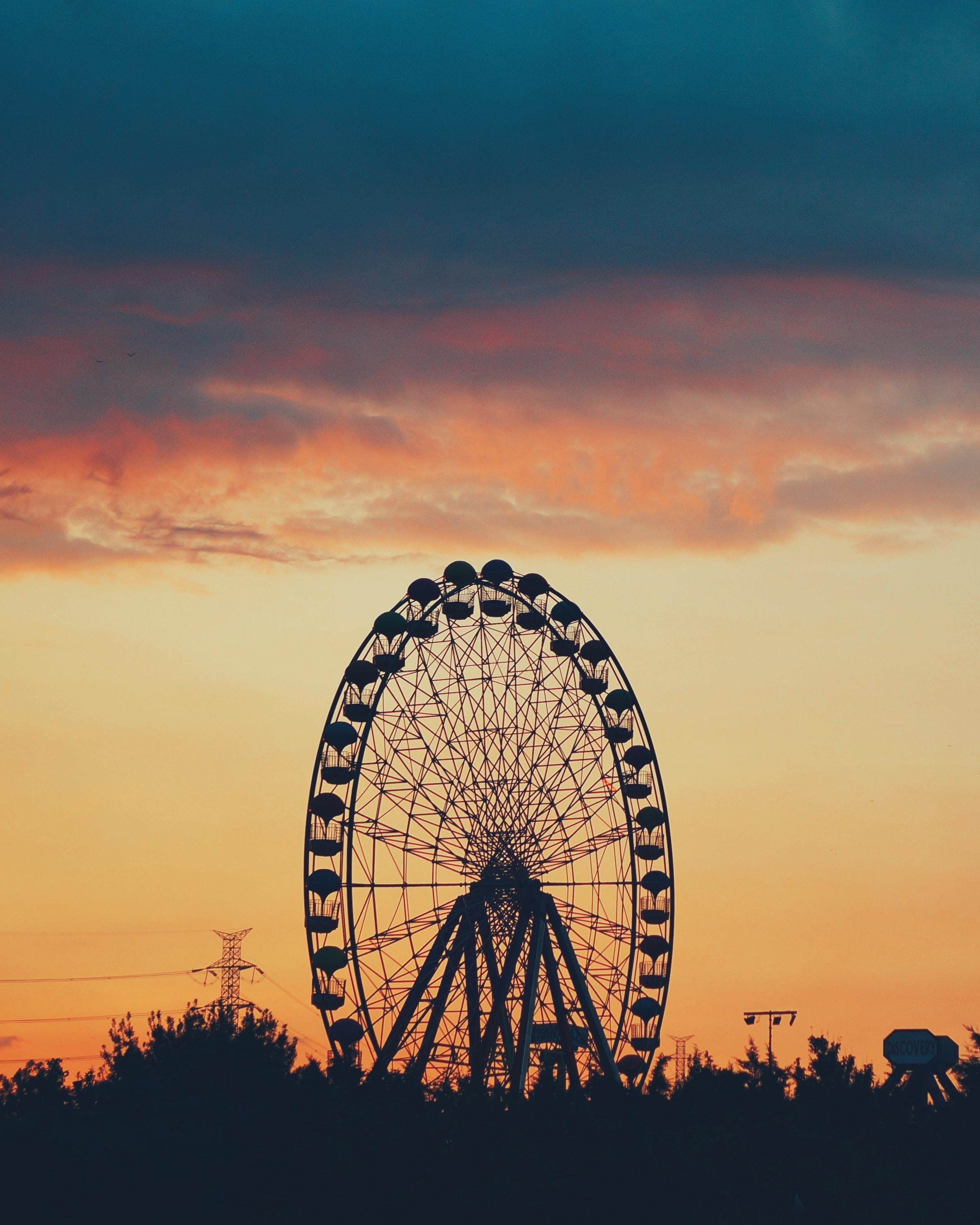 silhouette of Ferris wheel during golden hour